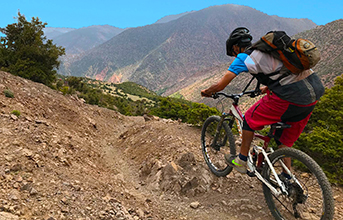 Andy Nelson with a Mountain Bike Morocco backdrop.